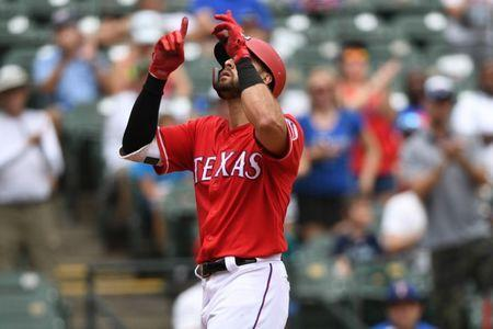 Aug 8, 2018; Arlington, TX, USA; Texas Rangers third baseman Joey Gallo (13) crosses home plate after hitting a home run during the third inning against the Seattle Mariners at Globe Life Park in Arlington. Shanna Lockwood-USA TODAY Sports