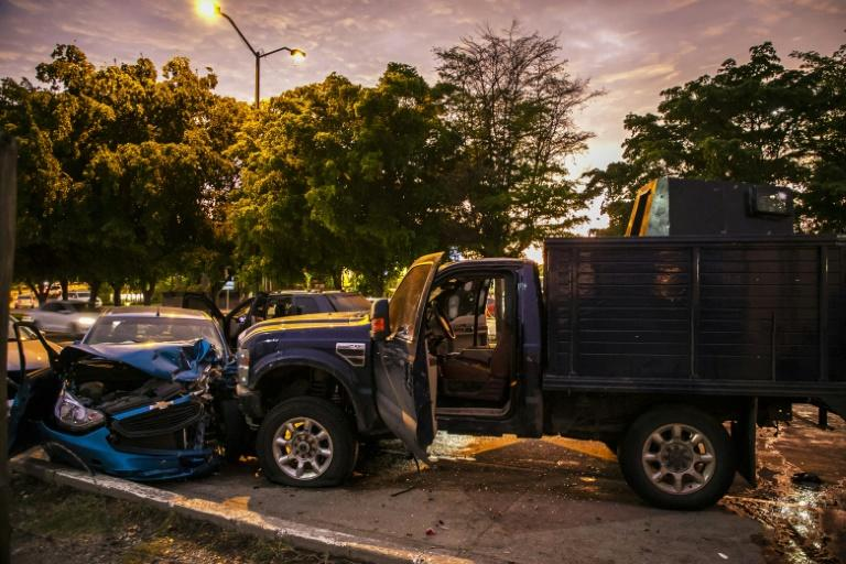 """View of bullet-ridden and crashed vehicles in Culiacan, Mexico, after heavily armed gunmen in four-by-four trucks fought an intense battle with Mexican security forces triggered by the arrest of a son of jailed drug kingpin Joaquin """"El Chapo"""" Guzman"""