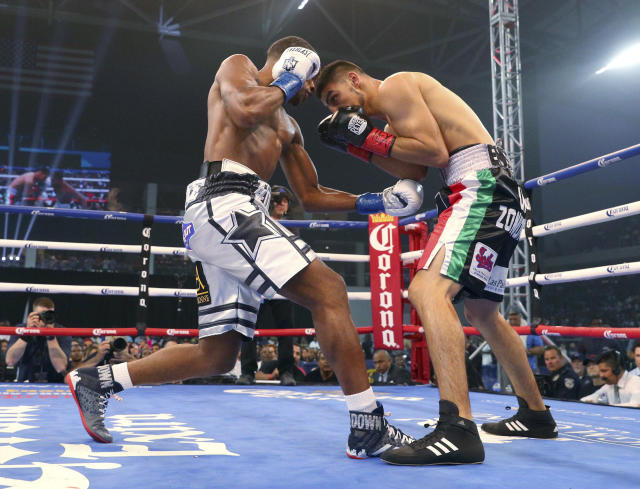 Errol Spence Jr. hits Carlos Ocampo with a left during the first round of an IBF welterweight title boxing match Saturday, June 16, 2018, in Frisco, Texas. (AP Photo/Richard W. Rodriguez)