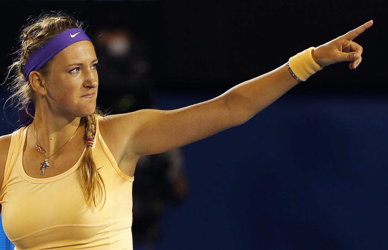 Victoria Azarenka of Belarus celebrates defeating Li Na of China during their women's singles final match at the Australian Open tennis tournament in Melbourne, January 26, 2013.  REUTERS/Damir Sagolj (AUSTRALIA  - Tags: SPORT TENNIS TPX IMAGES OF THE DAY)   - RTR3CZFN