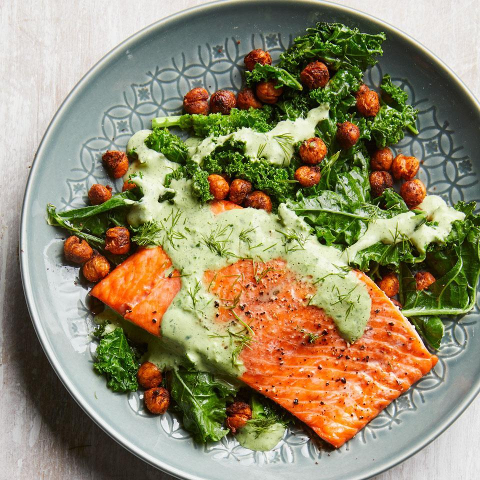 """<p>In this healthy salmon dinner, you'll get a dose of greens and green dressing! Chowing down on 6 or more servings of dark leafy greens a week can help keep your brain in top shape. This dish features the Test Kitchen's current go-to method for doctoring a can of chickpeas: spice them up and roast until crispy. <a href=""""http://www.eatingwell.com/recipe/262763/roasted-salmon-with-smoky-chickpeas-greens/"""" rel=""""nofollow noopener"""" target=""""_blank"""" data-ylk=""""slk:View recipe"""" class=""""link rapid-noclick-resp""""> View recipe </a></p>"""