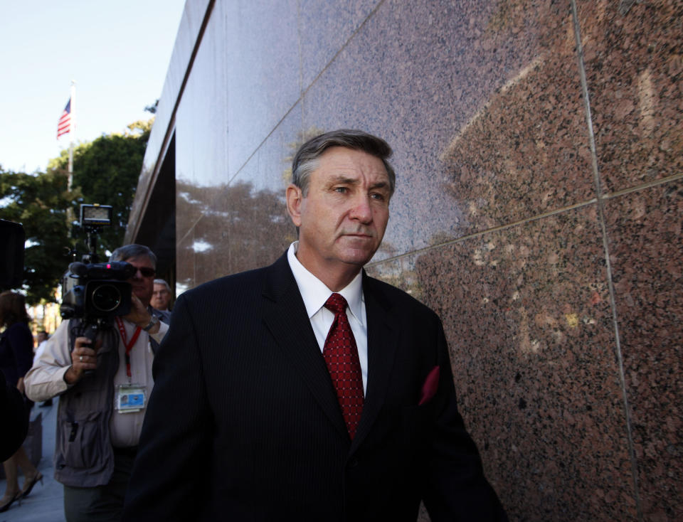 Jamie Spears, father of singer Britney Spears, leaves the Stanley Mosk Courthouse Wednesday, Oct. 24, 2012 in Los Angeles.  Sam Lutfi, who is suing Spears' parents for defamation, testified Wednesday while they watched from across the courtroom. (AP Photo/Nick Ut)