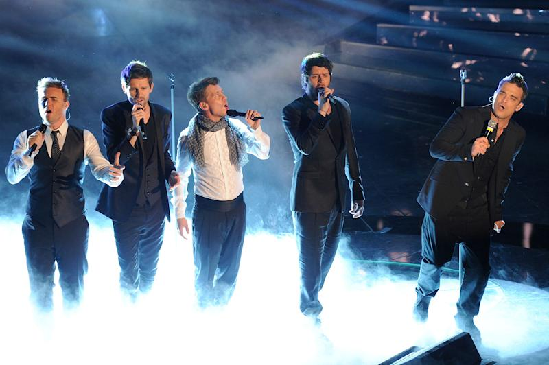 Gary Barlow, Howard Donald, Jason Orange, Mark Owen and Robbie Williams of the British band 'Take That' perform the 61th Sanremo Song Festival at the Ariston Theatre on February 18, 2011 in San Remo, Italy. (Photo by Venturelli/WireImage)