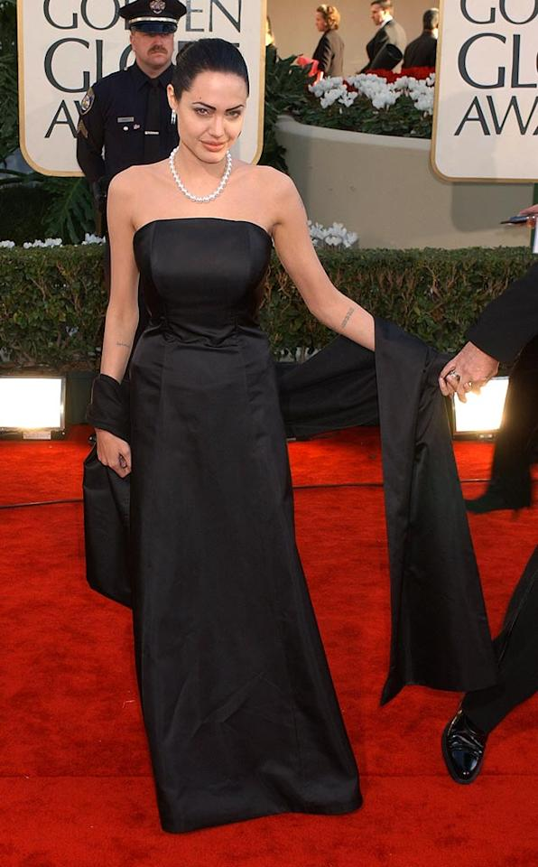 """Angelina Jolie's all-black ensemble from 2002 was a tad too dramatic for the lighthearted ceremony, where celebs are known to guzzle champagne, chat with friends during commercial breaks, and make hilarious acceptance speeches. Gregg DeGuire/<a href=""""http://www.wireimage.com"""" target=""""new"""">WireImage.com</a> - January 20, 2002"""
