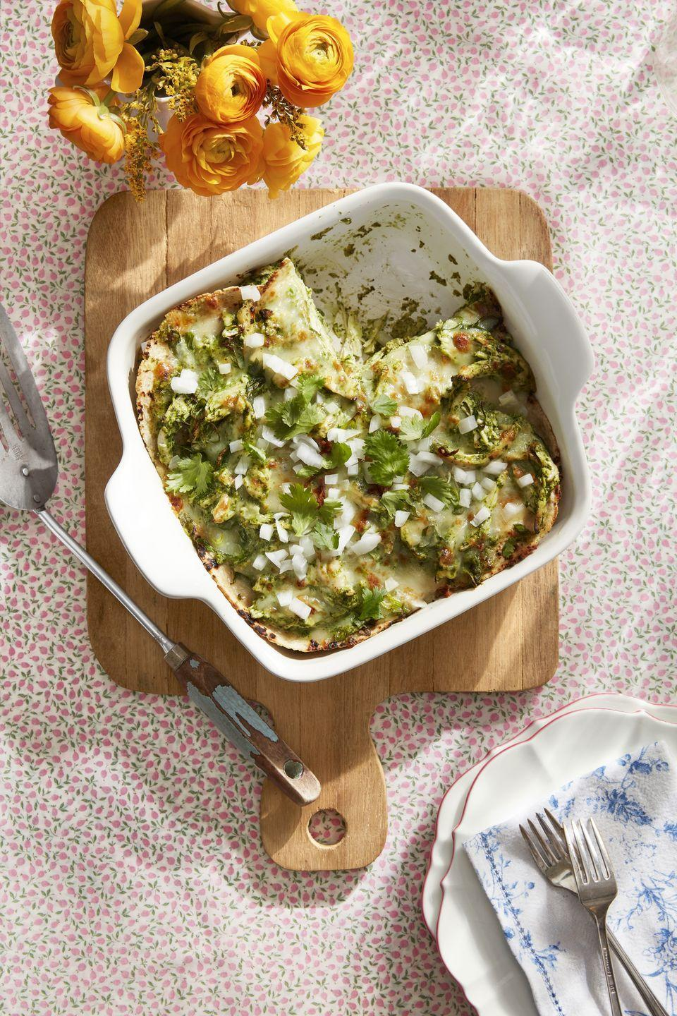 """<p>Fresh corn tortillas make up the layers of this Mexican-inspired pie that's flavored with green salsa and fresh cilantro. </p><p><strong><a href=""""https://www.countryliving.com/food-drinks/a30613447/salsa-verde-enchilada-pie-recipe/"""" rel=""""nofollow noopener"""" target=""""_blank"""" data-ylk=""""slk:Get the recipe"""" class=""""link rapid-noclick-resp"""">Get the recipe</a>.</strong></p>"""