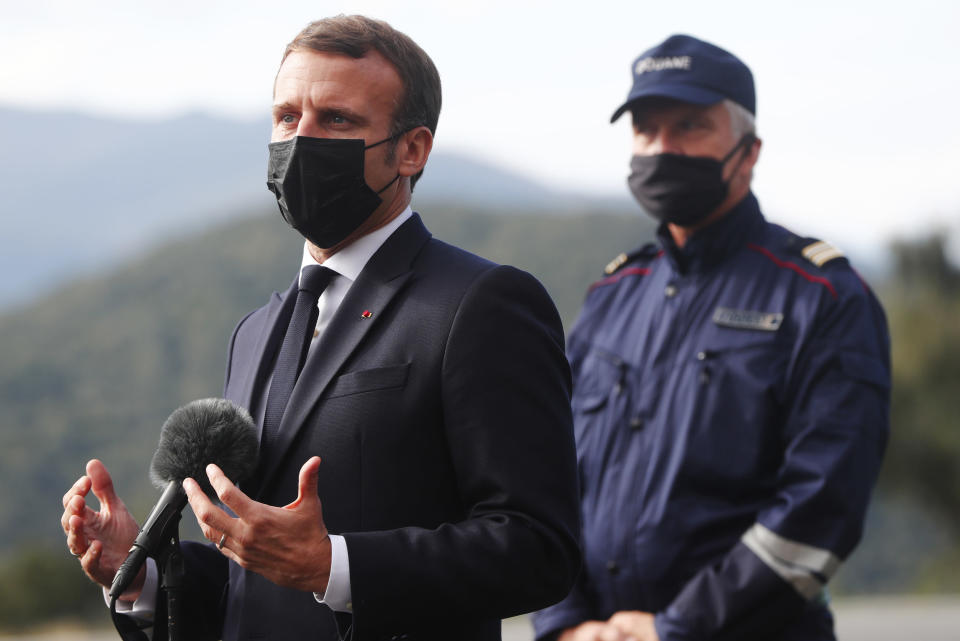 French President Emmanuel Macron addresses to reporters during a visit on the strengthening border controls at the crossing between Spain and France, at Le Perthus, France, Thursday, Nov. 5, 2020. (Guillaume Horcajuelo, Pool via AP)