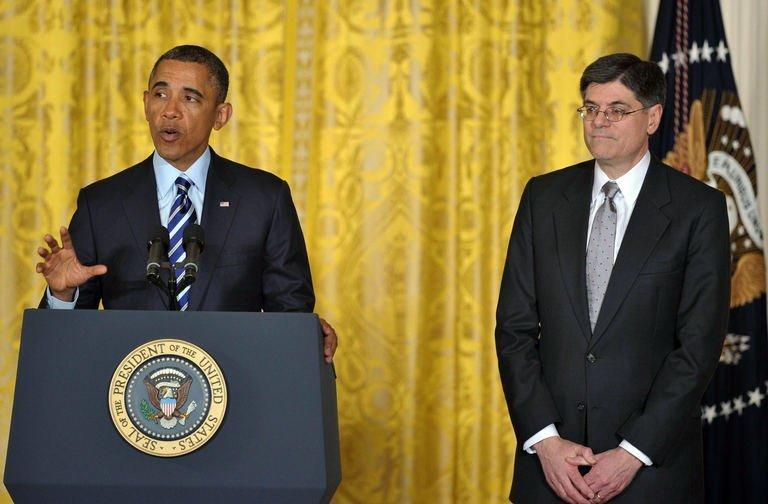 US President Barack Obama announces his choice of Jack Lew (R) as the next Treasury Secretary in the East Room of the White House on January 10, 2013 in Washington, DC
