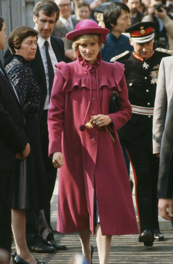 <p>Princess Diana knows that ruffles and pom-poms go together—especially on a bright pink coat.<br></p>