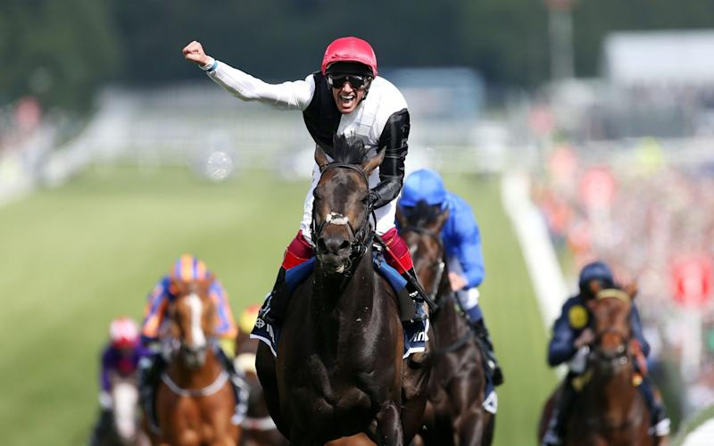 Frankie Dettori celebrates his victory on Golden Horn in the Investec Derby in 2015 - David Davies/PA Wir