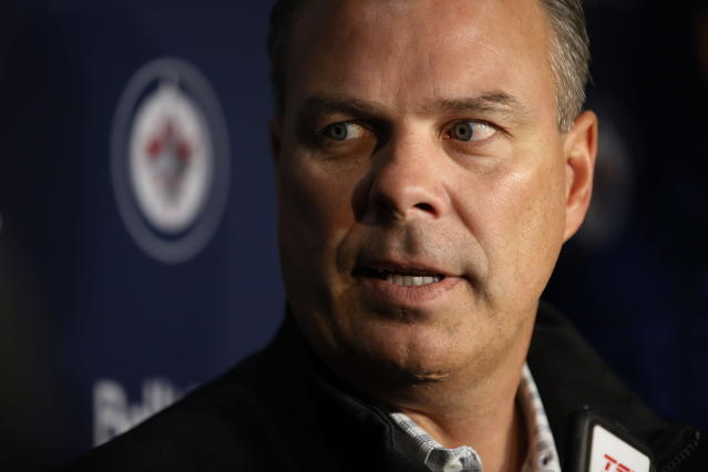 Winnipeg Jets general manager Kevin Cheveldayoff talks to media during the first day of the NHL training camp in Winnipeg, Manitoba, Friday, Sept. 13, 2019. (John Woods/The Canadian Press via AP)