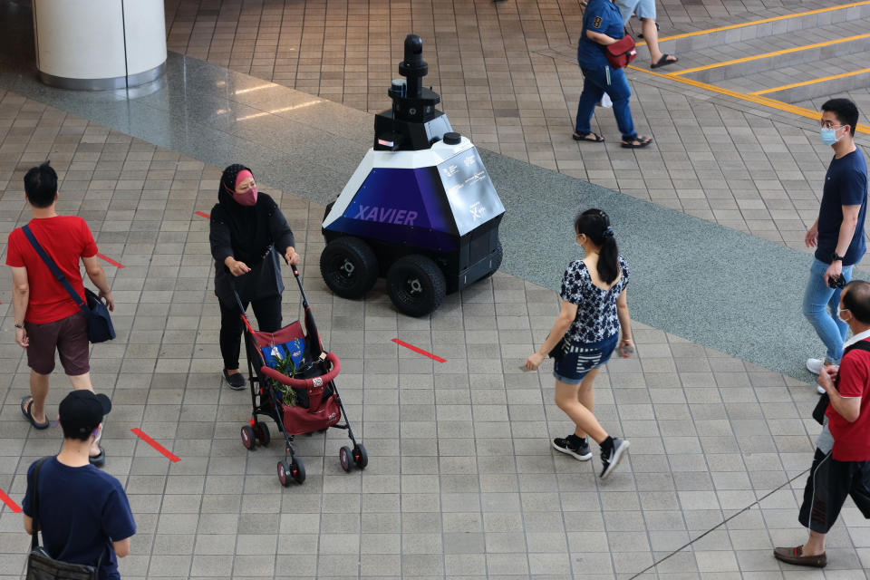 An HTX (Home Team Science and Technology Agency) ground robot, named Xavier patrols a neighbourhood mall to support public officers in enhancing public health and safety on 8 September 2021 in Singapore. (Photo by Suhaimi Abdullah/NurPhoto via Getty Images)