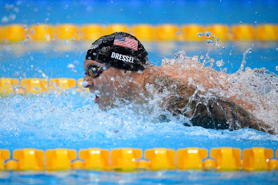 USA's Caeleb Dressel competes to break the Olympic Record in a semi-final of the men's 100m butterfly swimming event during the Tokyo 2020 Olympic Games at the Tokyo Aquatics Centre in Tokyo on July 30, 2021. (Photo by Oli SCARFF / AFP) (Photo by OLI SCARFF/AFP via Getty Images)