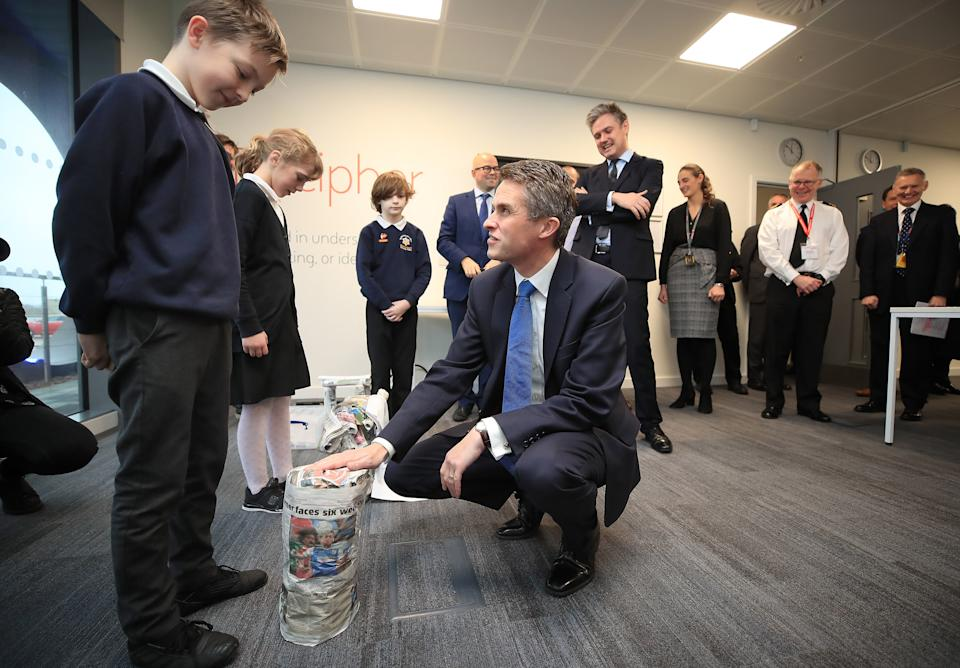 Defence Secretary Gavin Williamson meeting children from Barrow Island primary school making chairs, during a visit to BAE Systems Submarines, Barrow in Furness, Cumbria, to make an announcement regarding the Dreadnought programme.