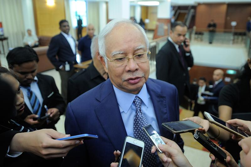Najib said he was now restricted from making remarks that may influence public opinion on 1MDB. — Picture by Shafwan Zaidon