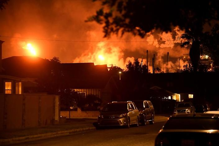 Carson, CA. September 17, 2021: The Marathon refinery burns in the background of a neighborhood after a 4.3 earthquake that was centered in Carson Friday night. (Wally Skalij/Los Angeles Times)