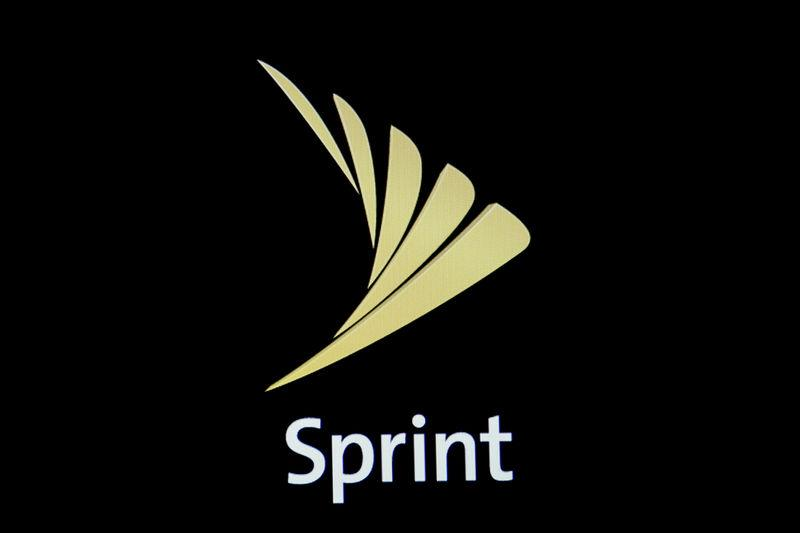 FILE PHOTO: The Sprint logo is displayed on a a screen on the floor of the NYSE in New York City