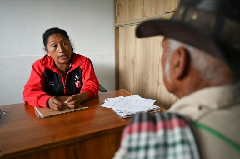 Since the 1970s, the indigenous peoples of the Cauca region of southwest Colombia, where Celia Umenza lives, have been fighting an expansion by sugarcane growers they say are driving them from the fertile lowlands they rely on for survival (AFP/LUIS ROBAYO)