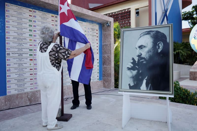 An image of late Cuban President Fidel Castro is seen prior to a farewell ceremony of Cuban doctors heading to Italy to assist, amid concerns about the spread of the coronavirus disease outbreak, in Havana