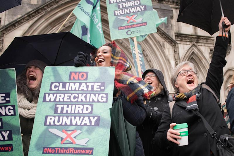 Campaigners cheer outside the Royal Courts of Justice in London after they won a Court of Appeal challenge against controversial plans for a third runway at Heathrow. PA Photo. Picture date: Thursday February 27, 2020. See PA story COURTS Heathrow. Photo credit should read: Stefan Rousseau/PA Wire