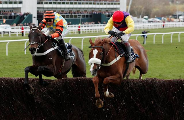 Horse Racing - Cheltenham Festival - Cheltenham Racecourse, Cheltenham, Britain - March 16, 2018 Native River ridden by Richard Johnson in action before winning the 15.30 Timico Cheltenham Gold Cup Chase Action Images via Reuters/Andrew Boyers