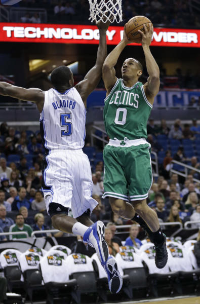 Boston Celtics' Avery Bradley takes a shot past Orlando Magic's Victor Oladipo (5) during the first half of an NBA basketball game in Orlando, Fla., Sunday, Jan. 19, 2014.(AP Photo/John Raoux)