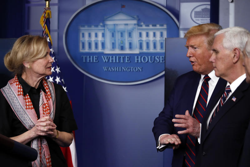 President Donald Trump gestures as he speaks to Dr. Deborah Birx, White House coronavirus response coordinator, during a briefing about the coronavirus in the James Brady Press Briefing Room of the White House, Thursday, April 2, 2020, in Washington, as Vice President Mike Pence watches. (AP Photo/Alex Brandon)