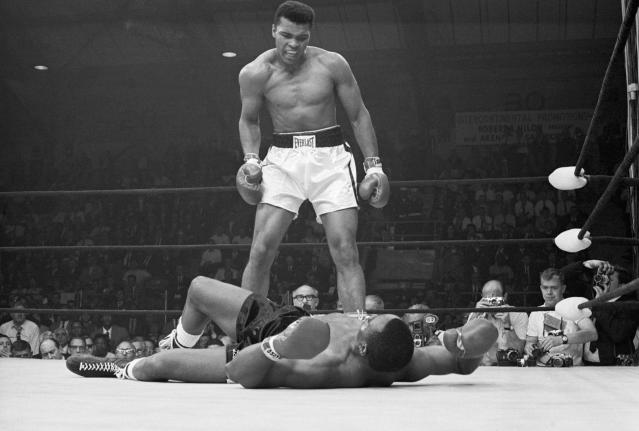 Muhammad Ali taunting Sonny Liston after knocking him out in 1965. (Photo: Getty Images).