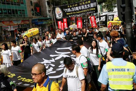 Protesters take part in a march ahead of June 4 anniversary of military crackdown on pro-democracy protesters in Tiananmen Square, in Hong Kong
