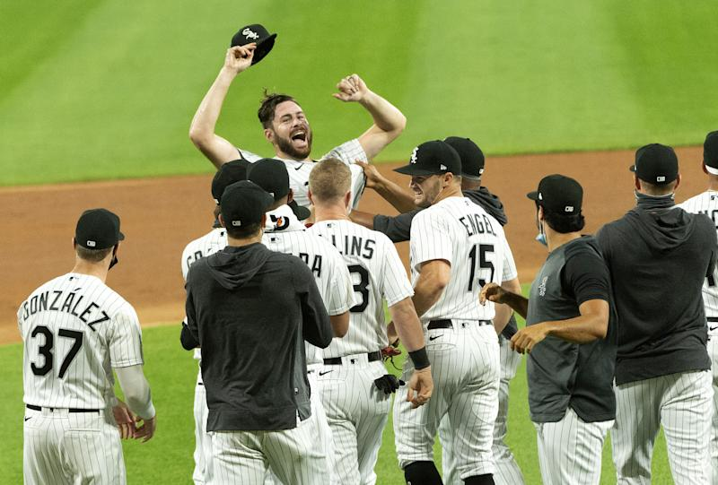 CHICAGO - AUGUST 25: Lucas Giolito #27 of the Chicago White Sox celebrates with teammates after recording the final out of his no-hitter against the Pittsburgh Pirates on August 25, 2020 at Guaranteed Rate Field in Chicago, Illinois. (Photo by Ron Vesely/Getty Images)