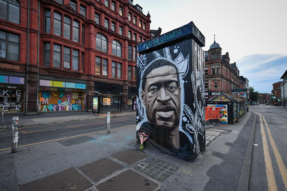MANCHESTER, UNITED KINGDOM - 2020/06/02: A freshly painted mural of the late George Floyd, has been created by the artist AKSE in Stevenson square, Manchester. A mural of the late George Floyd, created in Manchester city centre. (Photo by Kenny Brown/SOPA Images/LightRocket via Getty Images)