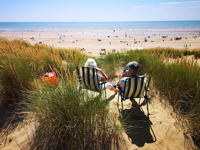 People enjoying the warm weather at Camber, East Sussex in July this year. (PA)