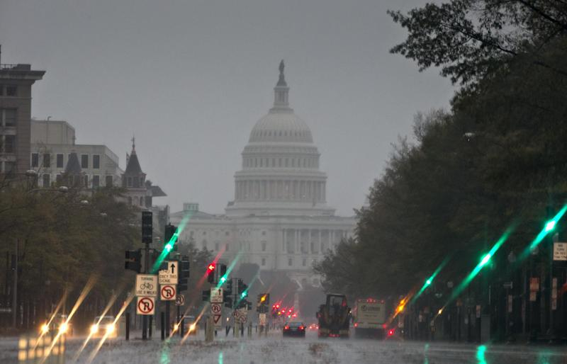 The U.S. Capitol and Pennsylvania Avenue are seen Monday morning, Oct. 29, 2012, as heavy rain from Hurricane Sandy arrives in Washington. Sandy strengthened before dawn and is on a predicted path toward Washington, Baltimore, Philadelphia and New York — putting it on a collision course with two other weather systems that would create a superstorm. (AP Photo/J. Scott Applewhite)