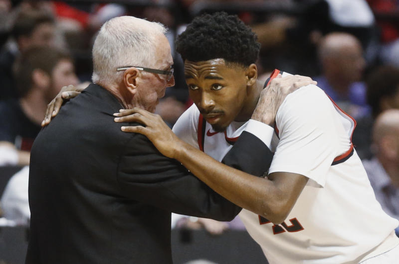 FILE - In this Dec. 22, 2015, file photo, San Diego State coach Steve Fisher talks with guard Jeremy Hemsley during the first half of the team's NCAA college basketball game against Kansas in San Diego. Two people with knowledge of the situation said Monday, April 10, 2017, that Fisher is retiring after spending 18 seasons as San Diego State's basketball coach. (AP Photo/Lenny Ignelzi, File)