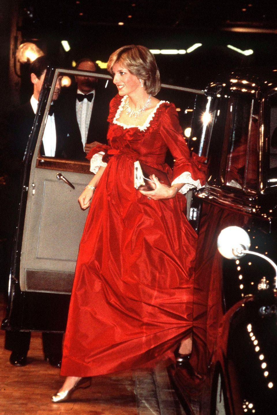 <p>In a red satin gown and silver ballet flats arriving at The Barbican Centre in London while pregnant with Prince William.</p>
