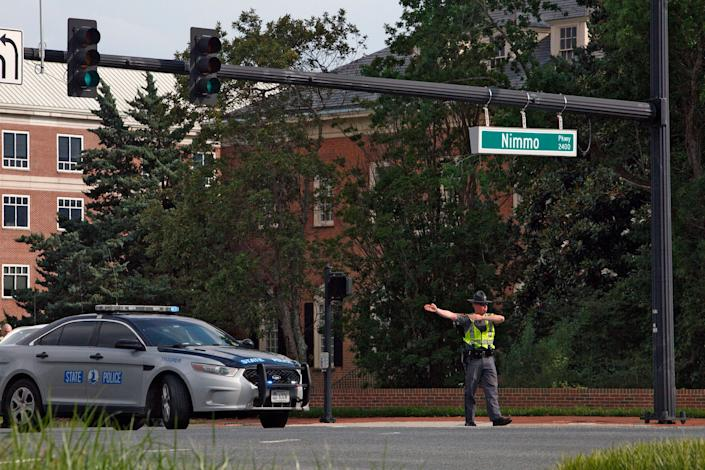 A police officer directs traffic away from the intersection of Princess Anne Road and Nimmo Parkway following a shooting at the Virginia Beach Municipal Center on May 31, 2019, in Virginia Beach, Va. (Photo: Kaitlin McKeown/The Virginian-Pilot via AP)