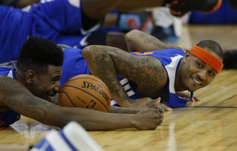"""New York Knicks forward Carmelo Anthony, right, and guard Iman Shumpert, left, who had offseason surgery to correct a torn left ACL, take part in a training session at the 02 arena in London, Wednesday, Jan. 16, 2013. The Detroit Pistons are due to play a """"home"""" NBA league game against the New York Knicks at the arena on Thursday. (AP Photo/Matt Dunham)"""