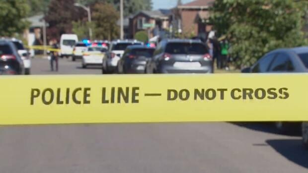 Several police vehicles parked at a shooting scene on residential street in Brampton July 28, 2020, as police officers keep people back from police tape. Last year, police responded to about 20,000 incidents of family and intimate-partner violence.