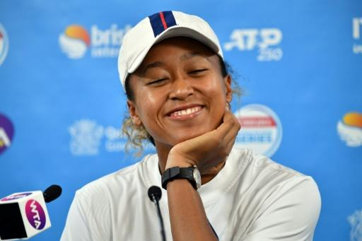 She's loving it: Naomi Osaka appears to thrive on the attention at Brisbane last week