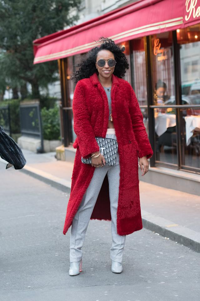 <p>Take your cozy later to the next level by opting for red outerwear instead of classic black, brown, or navy.</p>