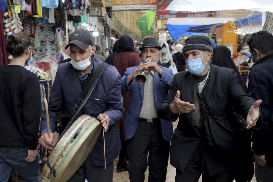 """Performers play folklore music welcoming Persian New Year, or Nowruz, meaning """"New Day."""" in northern Tajrish Square, Tehran, Iran, Wednesday, March 17, 2021. (AP Photo/Ebrahim Noroozi)"""