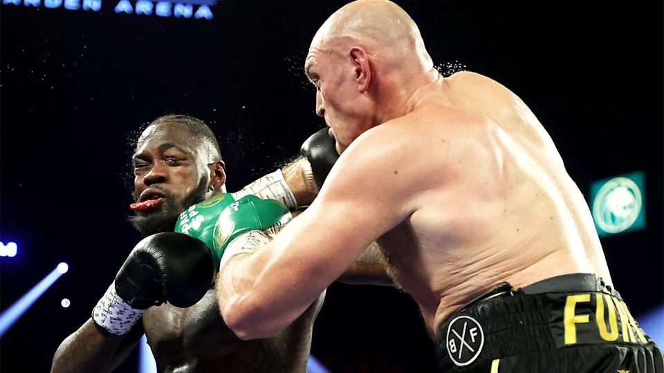 Deontay Wilder (pictured left) getting punched by Tyson Fury (pictured right).
