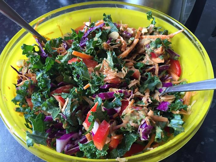"""<p>Perfect for summer, <a href=""""http://www.eatwithellen.com/2015/08/perfect-barbecue-salads/"""" rel=""""nofollow noopener"""" target=""""_blank"""" data-ylk=""""slk:this Asian-inspired dish"""" class=""""link rapid-noclick-resp"""">this Asian-inspired dish </a>contains a multicoloured medley of kale, shredded carrots, red cabbage - and a creamy peanut butter and ginger dressing. Yum. <i>[Photo: Eat With Ellen]</i></p>"""