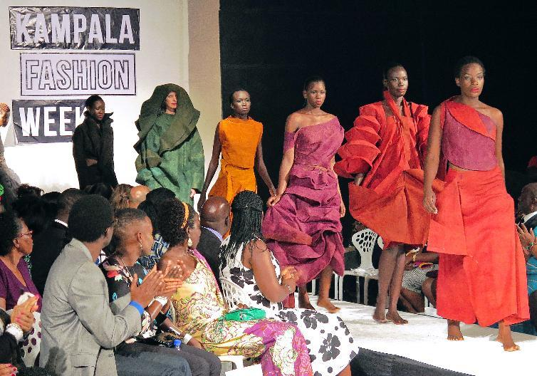 Models present creations made of bark cloth material by fashion designer Jose Hendo during the first fashion week show held in Kampala, on November 15, 2014 (AFP Photo/Amy Fallon)