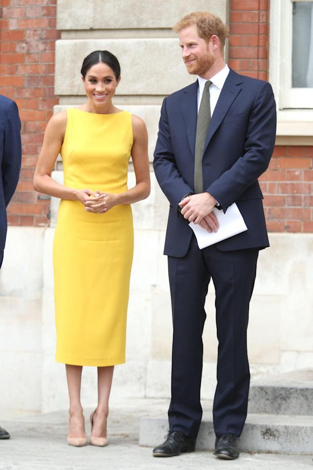 "Meghan Markle dazzles in yellow as she joins Prince Harry at the ""Your Commonwealth"" youth reception in London. (Photo: AP Images)"