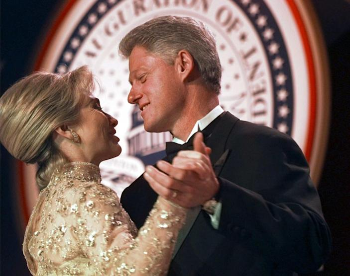 <p>President Bill Clinton dances with his wife, Hillary, at the Veterans Ball in January 1997, in Washington, D.C. (Photo: Doug Mills/AP)</p>
