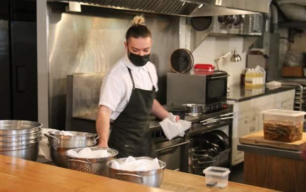 Candide Restaurant managed to hold onto staff like line-cook Gabriel Gervais  (Rowan Kennedy/CBC  - image credit)