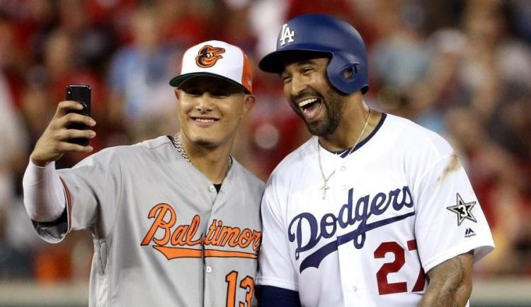 Manny Machado poses with new Dodgers teammate Matt Kemp during the All-Star Game. (AP)