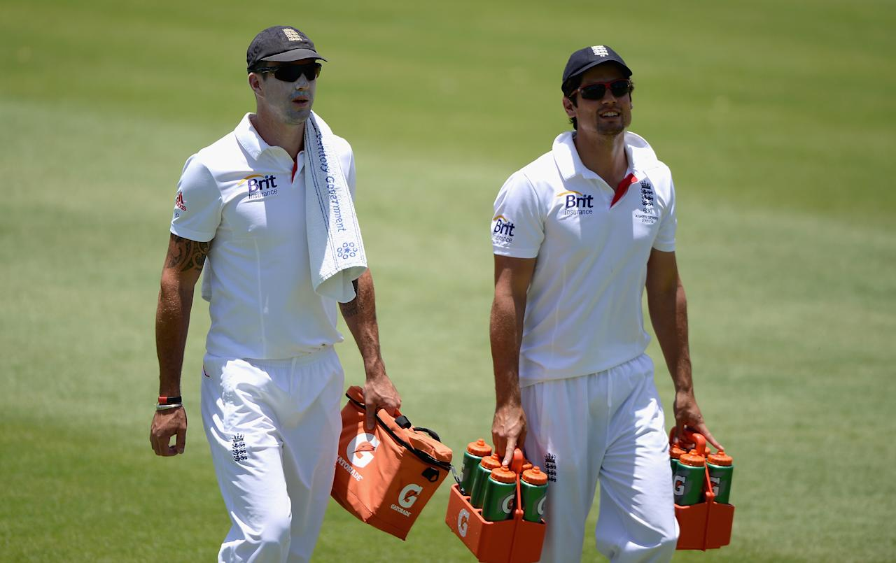ALICE SPRINGS, AUSTRALIA - NOVEMBER 30:  Kevin Pietersen and Alastair Cook of England carry on the drinks during day two of the tour match between the Chairman's XI and England at Traeger Park on November 30, 2013 in Alice Springs, Australia.  (Photo by Gareth Copley/Getty Images)