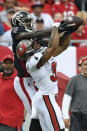 Tampa Bay Buccaneers safety Antoine Winfield Jr. (31) knocks a pass away from Atlanta Falcons wide receiver Calvin Ridley (18) during the first half of an NFL football game Sunday, Sept. 19, 2021, in Tampa, Fla. (AP Photo/Jason Behnken)