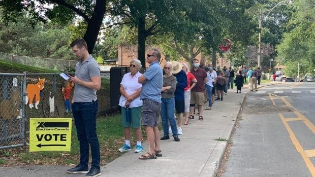 A long line at a polling station in Toronto on Sept. 20, 2021. (Christopher Mulligan/CBC - image credit)